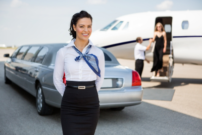 woman smiling with limo on her back